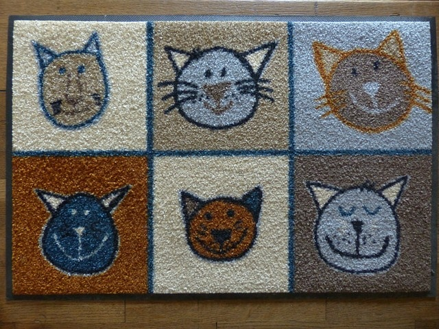 mat with cat faces